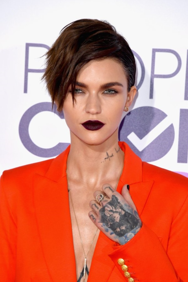e96161845 There is no shame in showing off your tattoos and Ruby Rose knows it!  Although it's almost impossible not to be a controversial person when you  are so ...