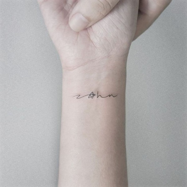 This Name Tattoo Is Interesting And It Contains A Star Too But Its Almost Impossible To Read
