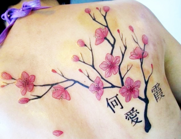 c5684d1b9 One of the secret benefits of back tattoos is you can cover up your ventosa  marks. The cherry blossom branches out, making the marks look natural.