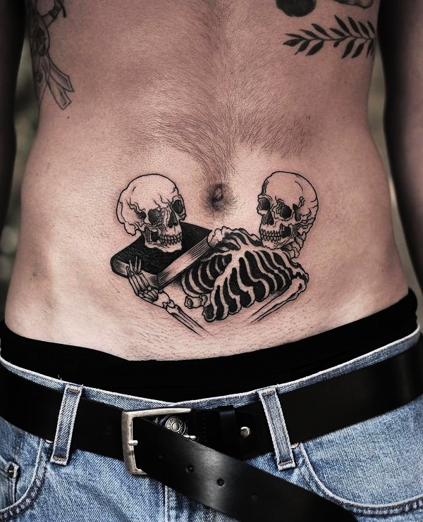 a619a6b7b6ebd There is no evident symbolism behind this tattoo apart from death and  knowledge. However, it looks manly and cool on this guy's lower stomach,  doesn't it?