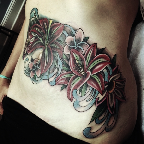 bff776ded Just as this chick found a flower design she loved, you can do the same  with the flowers you like and combine them for a lower stomach piece.