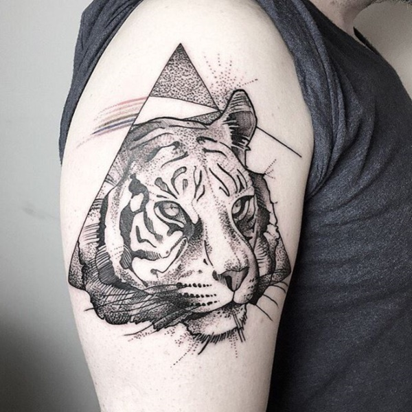 df5b9ed95 This tattoo combines the symbol from a Pink Floyd album with the black and  white portrait of a tiger.